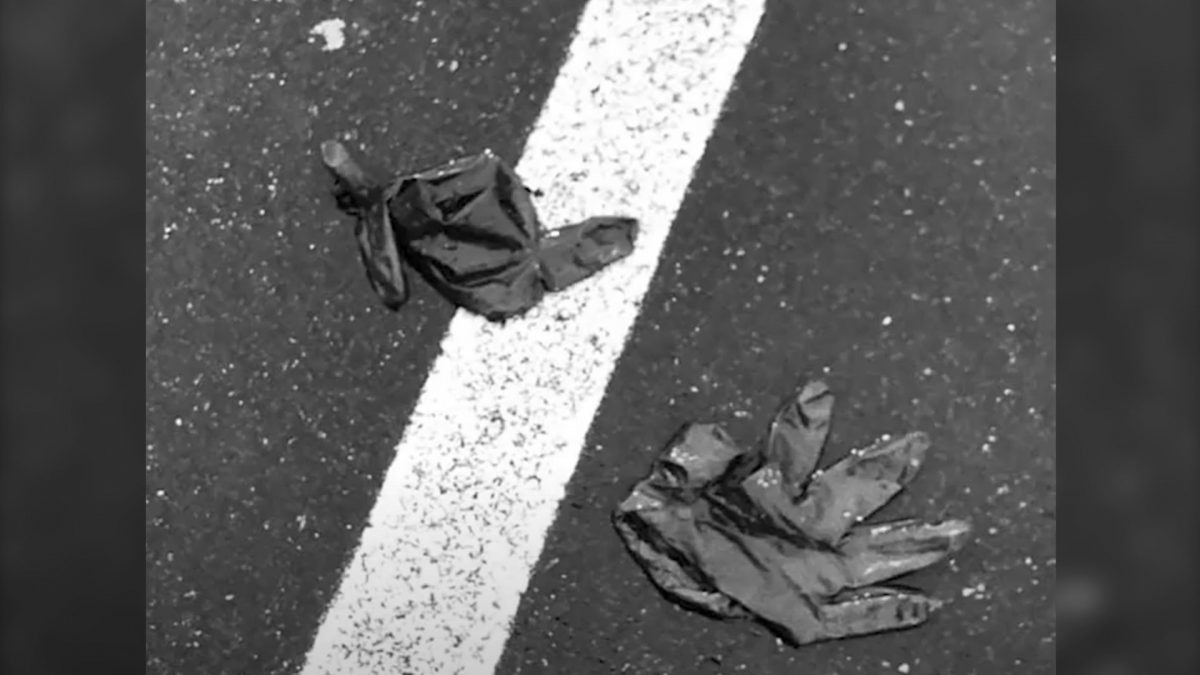 Two Black Gloves on the Ground