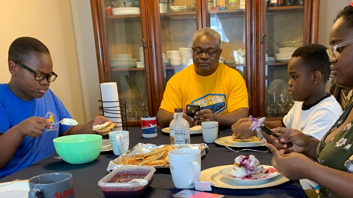 The Taku family eats breakfast at home.