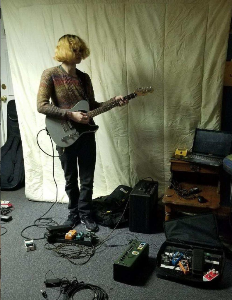 Nora Knoz Playing her Electric Guitar